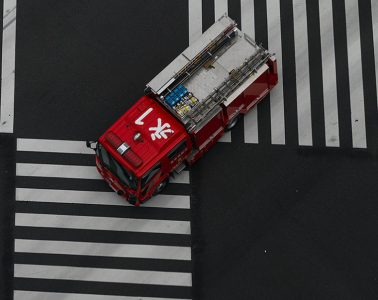 Fire engine passes through a zebra crossing, Ginza, Tokyo, Japan